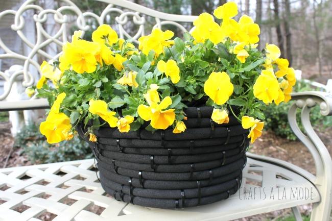 old garden hose flower pot