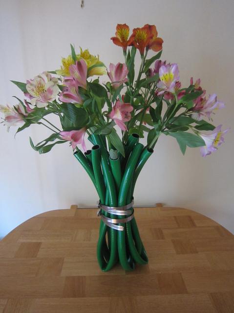 old garden hose flower vase